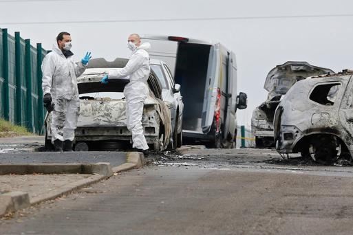 Police on the highway where thieves robbed an armoured truck near Dardilly in France. Photo: AP