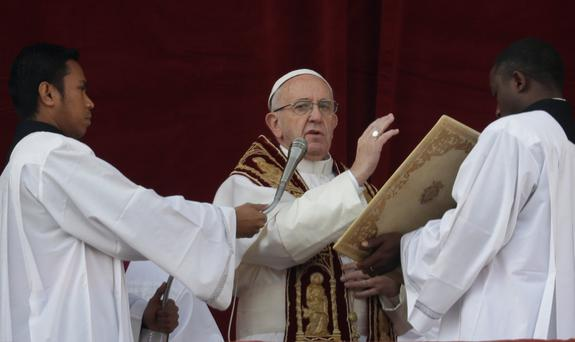 Pope Francis delivers the 'Urbi Et Orbi' Christmas day blessing at the Vatican yesterday. Photo: AP