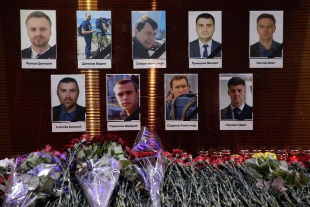 Portraits of journalists killed in the crash are put on display at a memorial in Moscow. Photo: AP