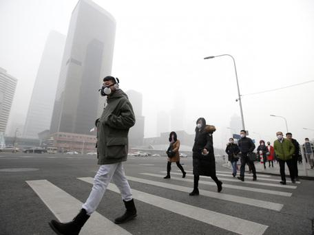 Almost three years since the nation 'declared war' on pollution, stretches of the country remain plagued by smog Photo: Reuters