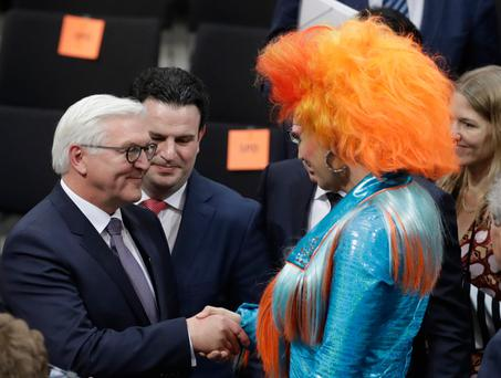 New German President Frank-Walter Steinmeier is congratulated by drag queen Olivia Jones, who is a member of the electoral college, after his election victory was confirmed in Berlin yesterday. The former foreign minister has been a vocal critic of Donald Trump. Photo: AP