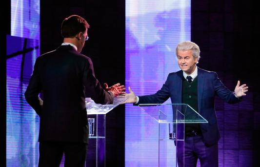 Dutch far-right politician Geert Wilders (right), of the PVV party, and Dutch Prime Minister Mark Rutte, of the VVD Liberal party, take part in a TV debate in Rotterdam last night. Photo: Getty Images