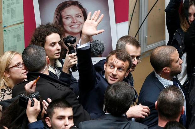 Emmanuel Macron, head of the political movement En Marche! (or Onwards!) and presidential candidate, waves as he visits the university of Lille. Photo: Reuters