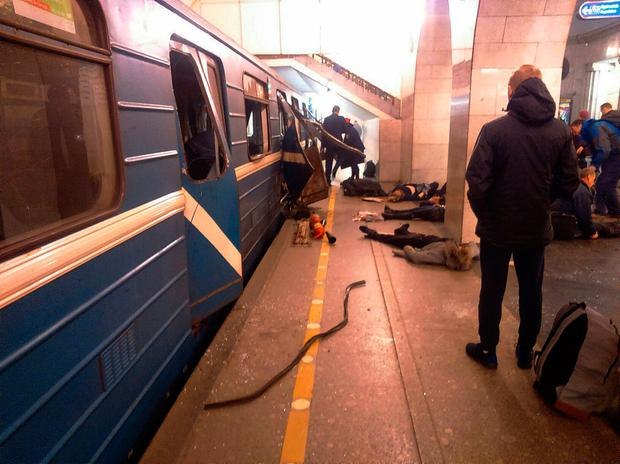 Victims of the blast lie on the ground near a destroyed carriage at the Technology Institute subway station in St Petersburg. Photo: AP Photo/DTP&ChP St. Peterburg via AP