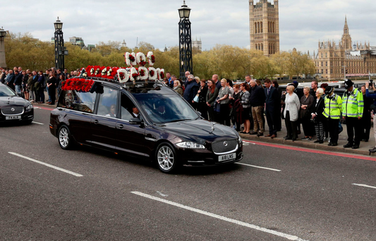The coffin of PC Keith Palmer crosses Lambeth Bridge with the Houses of Parliament in the background on its way to Southwark Cathedral in London. Photo: PA