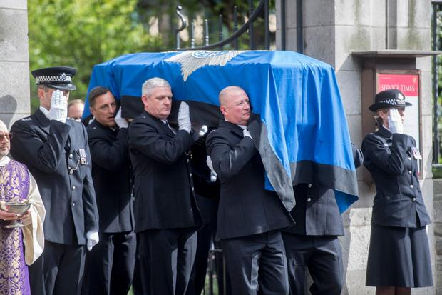 The coffin of PC Keith Palmer arrives at Southwark Cathedral. Photo: PA