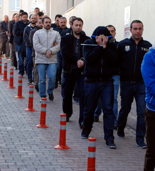 Suspected supporters of Fethullah Gulen are escorted by police in Kayseri, Turkey. Photo: Olcay Duzgun/Dogan News Agency/via Reuters