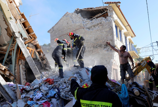 Rescue team members search for victims at a collapsed building in the village of Vrissa on the Greek island of Lesbos, Greece, after a strong earthquake shook the eastern Aegean, June 12, 2017. REUTERS/Giorgos Moutafis TPX IMAGES OF THE DAY