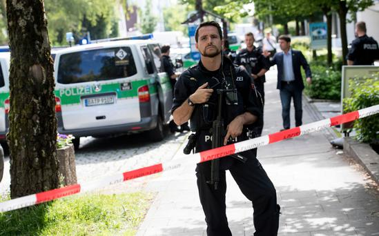 Police block a street near a subway station in Munich, Germany where a number of people were shot.