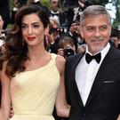 Actor George Clooney with his wife Amal. Photo: Getty