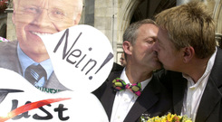 A Munich gay couple kiss as they protest in Munich against the Bavarian state government in August 2001. Photo: Reuters