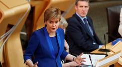 Scotland's First Minister Nicola Sturgeon addresses the Scottish Parliament in Edinburgh. Photo: Reuters