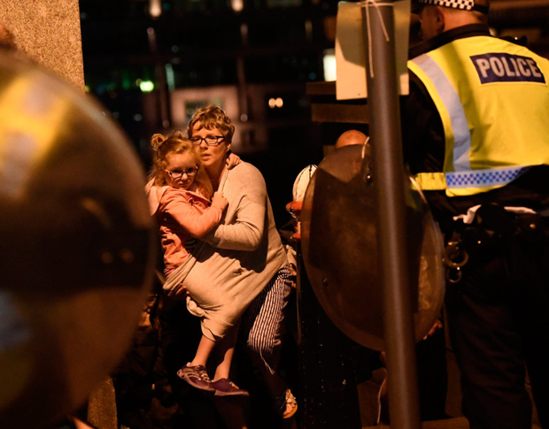 People are lead to safety after the attack on London Bridge.
