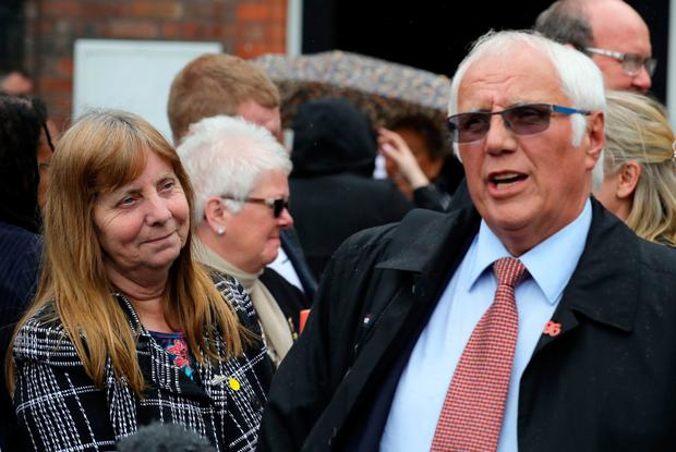 Margaret Aspinall of the Hillsborough Family Support Group listens to Trevor Hicks, whose two daughters died, after yesterday's announcement. Photo: Getty