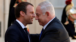 French President Emmanuel Macron greets Israeli Prime Minister Benjamin Netanyahu in Paris. Photo: Reuters