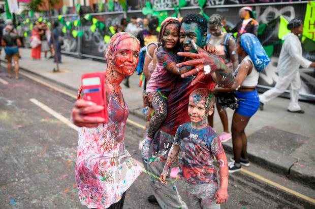 Paint-covered revellers take part in the opening parade of the Notting Hill carnival in London. Photo: Leon Neal/Getty Images