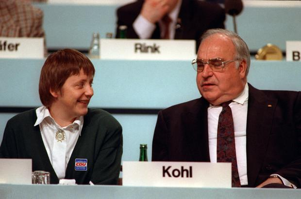 German Chancellor Helmut Kohl and his then-newly elected Minister for Women, Angela Merkel, at a CDU party meeting in 2001