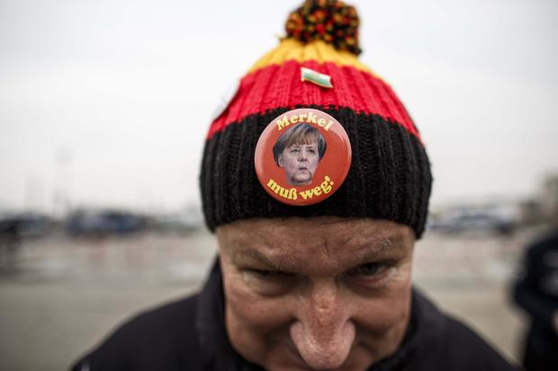 A protester wears a badge with the slogal