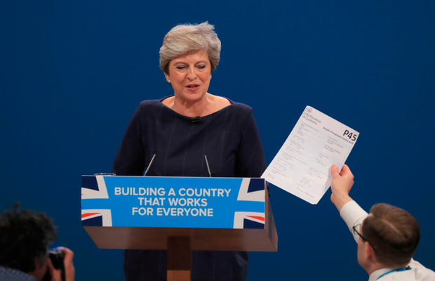 Comedian Simon Brodkin confronts British Prime Minister Theresa May with a P45 form during her keynote speech at the Conservative Party conference in Manchester yesterday. Photo: Peter Byrne/PA