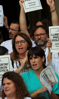 Medical workers protest during a gathering in Barcelona after the leaders of two Catalan separatist organisations were jailed by Spain's High Court. Photo: Reuters/Albert Gea
