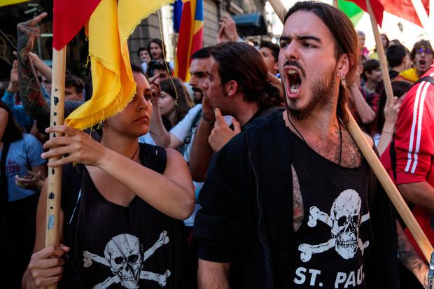 Protesters chant at a group of Spanish National Police during a Catalan pro-independence strike of university students yesterday in Barcelona. The Parliament of Catalonia will meet today for a two-day plenary session to debate the application of Article 155 of the Spanish Constitution in Catalonia. Photo: Jack Taylor/Getty