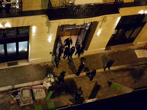 Police stand at the back entrance of the Ritz hotel in Paris. Photo: Reuters
