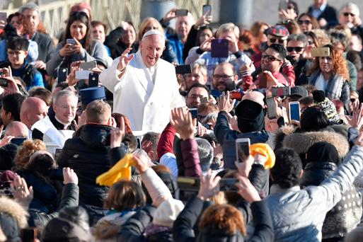 Pope Francis waves as he arrives in St Peter's Square yesterday. Photo: AFP/Getty Images