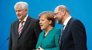 The Social Democratic Party's now former leader Martin Schulz, Christian Democratic Union (CDU) leader and German Chancellor Angela Merkel and Christian Social Union (CSU) leader Horst Seehofer give a statement on the success of talks to form a new coalition government in Berlin. Photo: Hannibal Hanschke/Reuters