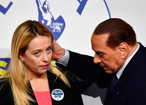 Leader of Italian right-wing party Forza Italia (Go Italy) Silvio Berlusconi embraces Giorgia Meloni, president of Brothers of Italy party, at the end of a joint press conference at the Tempio di Adriano in Rome. Photo: Alberto Pizzoli/AFP/Getty Images