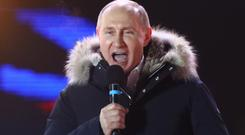 Vladimir Putin addresses a victory rally in Moscow last night. Photo: Reuters