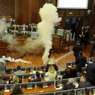 Kosovo opposition politicians release tear gas in the Pristina parliament to bring the session to an abrupt halt. Photo: Reuters