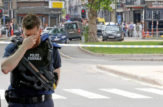 A police officer at the scene of the shooting in Liege. Photos: Reuters