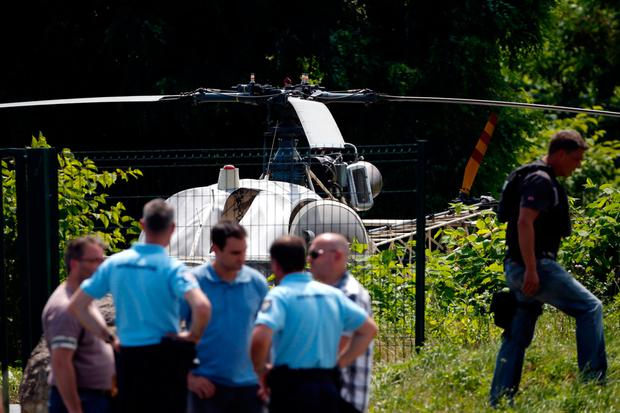 Police at the scene where the helicopter landed near a road in Gonesse, north of Paris. Photo: Getty