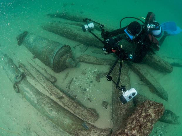 A diver photographs the centuries-old shipwreck in Cascais in Portugal. Photo: Reuters