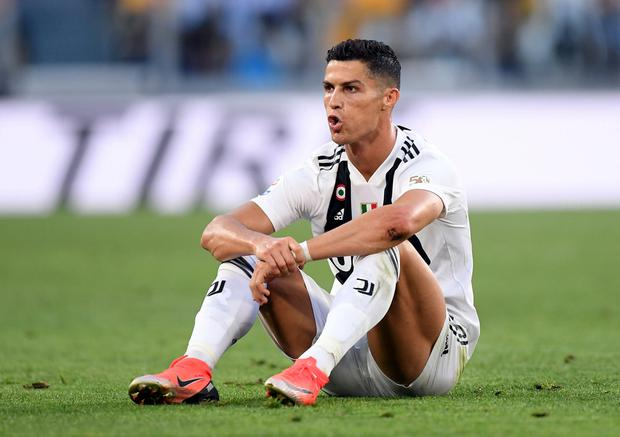 Denial: Portuguese superstar Cristiano Ronaldo says claims he raped a woman in 2009 are 'fake news'