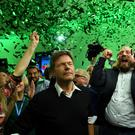 Green vote: Leaders of the German Green party react to the first exit polls in the Bavarian state elections in Munich last night. Photo: Reuters