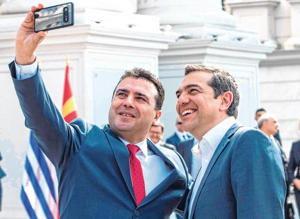 All smiles: North Macedonia premier Zoran Zaev (left) with Greek counterpart Alexis Tsipras. Photo: Getty Images