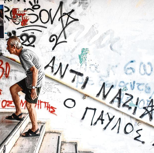 An eldery man arrives at a polling station to vote during the Greek general election in Athens. Photo: AFP/Getty