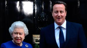 Asked for help: Queen Elizabeth and former UK prime minister David Cameron