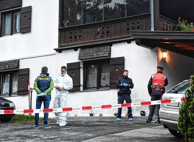 Investigation: Police officers at the scene of the killing in Kitzbuehel, Austria