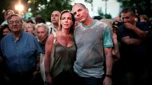 Greek Finance Minister Yanis Varoufakis (R) and his wife Danae Stratou attend a concert outside the Greek state broadcaster ERT in Athens. Photo: AFP/Getty Images