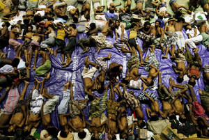 Migrants, believed to be Rohingya from Myanmar, rest inside a shelter after being rescued from boats at Lhoksukon, in Indonesia's Aceh Province. An estimated 6,000 more remain trapped in crowded wooden boats. Photo: Reuters