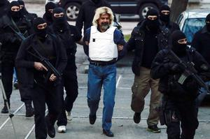 Greek fugitive Christodoulos Xiros is escorted by anti-terrorism police officers to the prosecutor in Athens