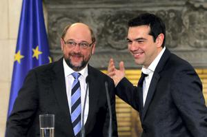 Greek Prime Minister Alexis Tsipras and European Parliament President Martin Schulz smile after their meeting in the Greek Premier's office in Athens.