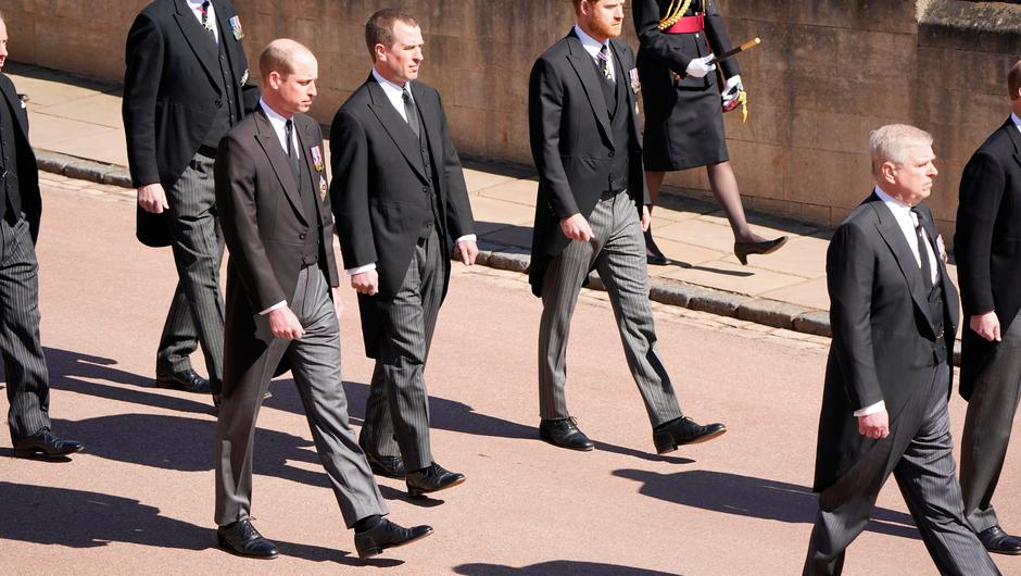 WINDSOR, ENGLAND - APRIL 17: Prince William, Duke of Cambridge, Peter Phillips, Prince Harry, Duke of Sussex, Earl of Snowdon David Armstrong-Jones, Vice-Admiral Sir Timothy Laurence and Prince Andrew, Duke of York follow Prince Philip, Duke of Edinburgh's coffin as it arrives at St George's Chapel during the funeral of Prince Philip, Duke of Edinburgh at Windsor Castle on April 17, 2021 in Windsor, United Kingdom. Prince Philip of Greece and Denmark was born 10 June 1921, in Greece. He served in the British Royal Navy and fought in WWII. He married the then Princess Elizabeth on 20 November 1947 and was created Duke of Edinburgh, Earl of Merioneth, and Baron Greenwich by King VI. He served as Prince Consort to Queen Elizabeth II until his death on April 9 2021, months short of his 100th birthday. His funeral takes place today at Windsor Castle with only 30 guests invited due to Coronavirus pandemic restrictions. (Photo by Paul Edwards-WPA Pool/Getty Images)