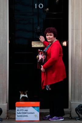 Claire Throssell, whose children were killed by her abusive ex-husband in 2014, hands in petition to Downing Street in London calling for an end to unsafe child contact with dangerous perpetrators of domestic violence. Photo: Stefan Rousseau/PA Wire