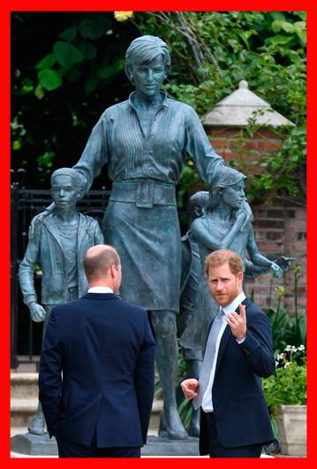 Prince William and Prince Harry unveil a statue they commissioned of their mother, Princess Diana, in the Sunken Garden at Kensington Palace in London. Photo: PA