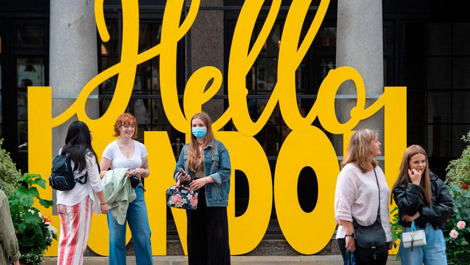 People wearing face masks among crowds of pedestrians in Covent Garden, London. Photo: Dominic Lipinski/PA Wire