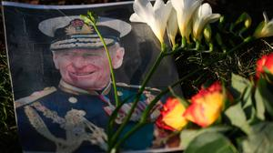 Tributes left outside Windsor Castle to Prince Philip. PA