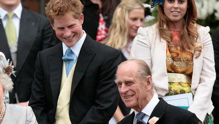 Prince Philip and Prince Harry share a joke at an event in 2008. Photo: PA